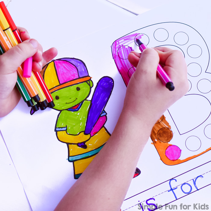 Child coloring a capital letter B.