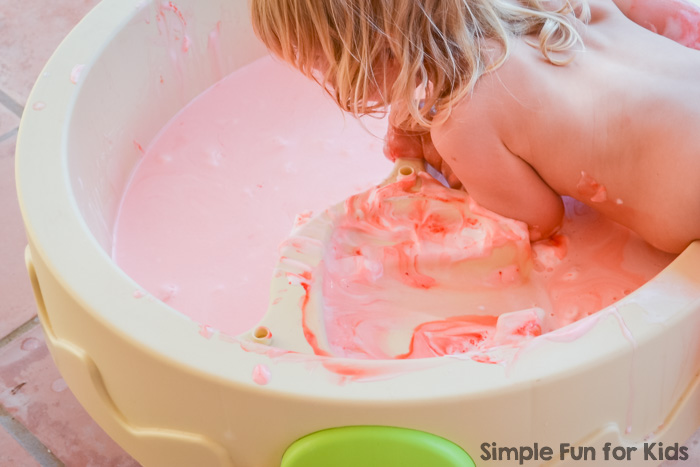 My toddler had awesome messy sensory fun with colored scented shaving cream in the water table! You won't believe how easy it was to clean it up afterward!