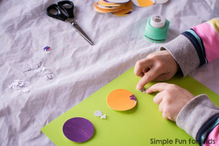 This colorful circles collage was so much fun to make! Plus, it also worked on hand strengthening and fine motor skills without even trying. It was perfect for my preschooler, but my toddler had a go, too, and didn't want to stop :)