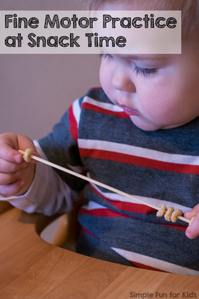 Simple and fun fine motor practice for toddlers at snack time with Cheerios and a skewer!