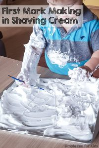 Read all about my toddler's first mark making in shaving cream experience! Simple, fun, very sensory, and great as a pre-writing activity!