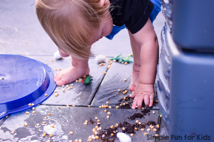 My toddler loved this awesome sensory play with dinosaurs - and went a little wild with the activity ;)