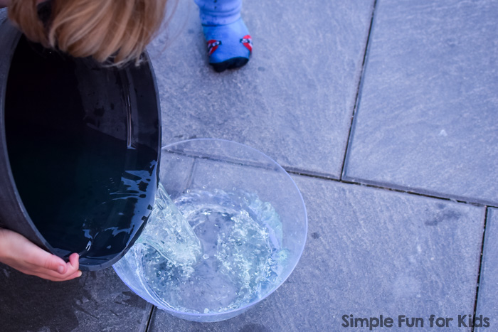 Simple sibling play with water: I set up a super simple stirring, pouring, and color mixing station in the water table for my toddler, and both he and my kindergartener had great fun with it!