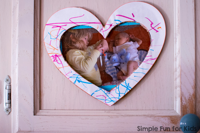 Use your toddler's art work to make this super simple heart picture frame craft! Great for Valentine's Day or just to display a favorite photo.